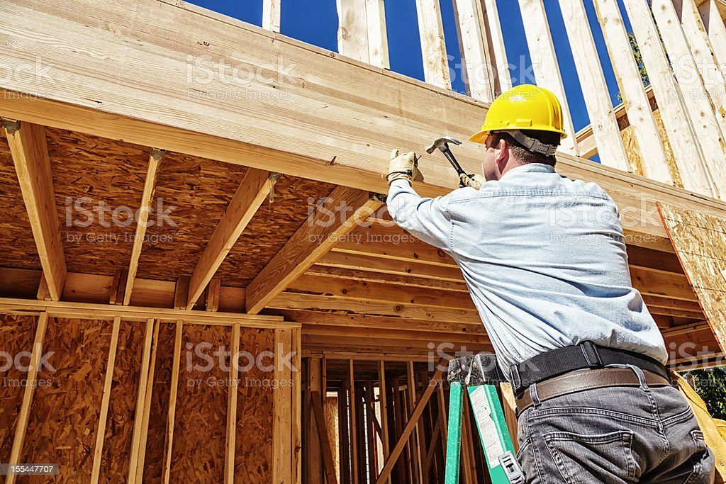 Construction Worker Hammering Nails royalty-free stock photo