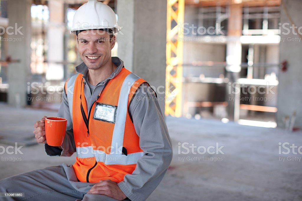 Construction worker having coffee break on construction site stock photo