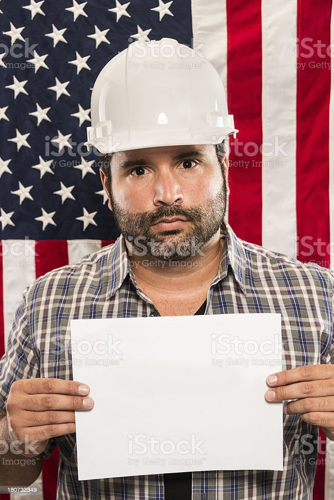 Construction worker holding a sign royalty-free stock photo