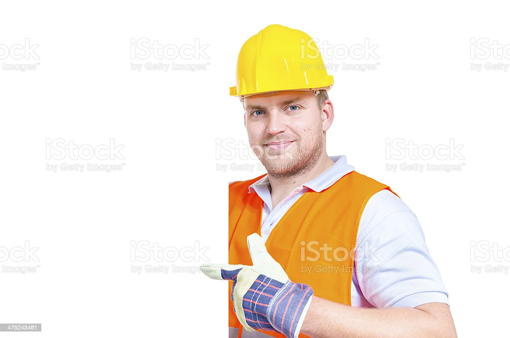 Construction worker holding blank sign royalty-free stock photo