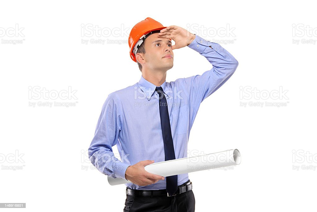 Construction worker holding blueprints and looking royalty-free stock photo
