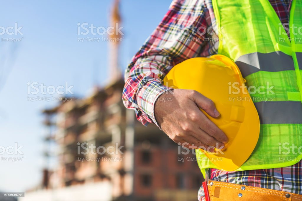 Construction Worker  holding helmet royalty-free stock photo