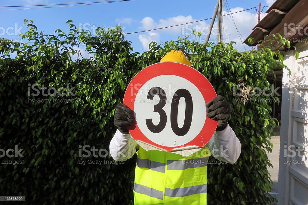 Construction worker Holding traffic sign stock photo