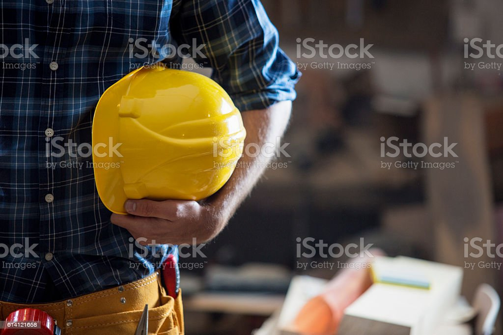 Construction worker holding yellow hemlet stock photo
