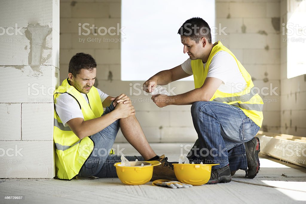 A construction worker hurt on the job stock photo