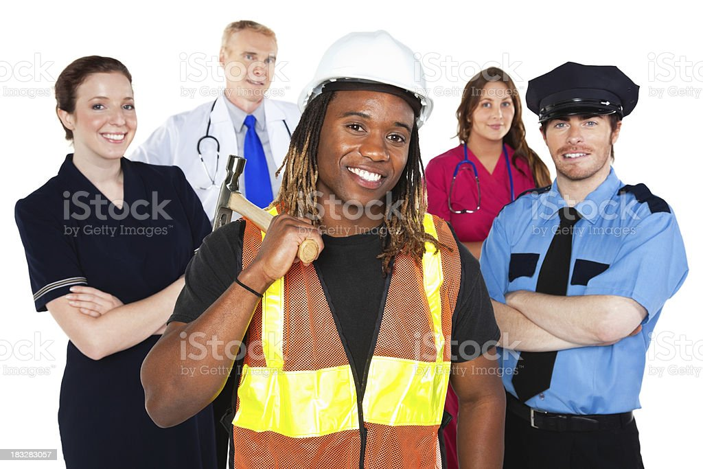 Construction Worker In Front Group of Professional People royalty-free stock photo