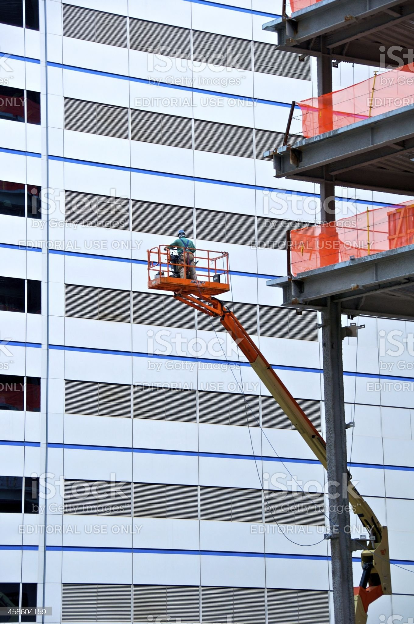 Construction worker in high lift platform, New York City royalty-free stock photo