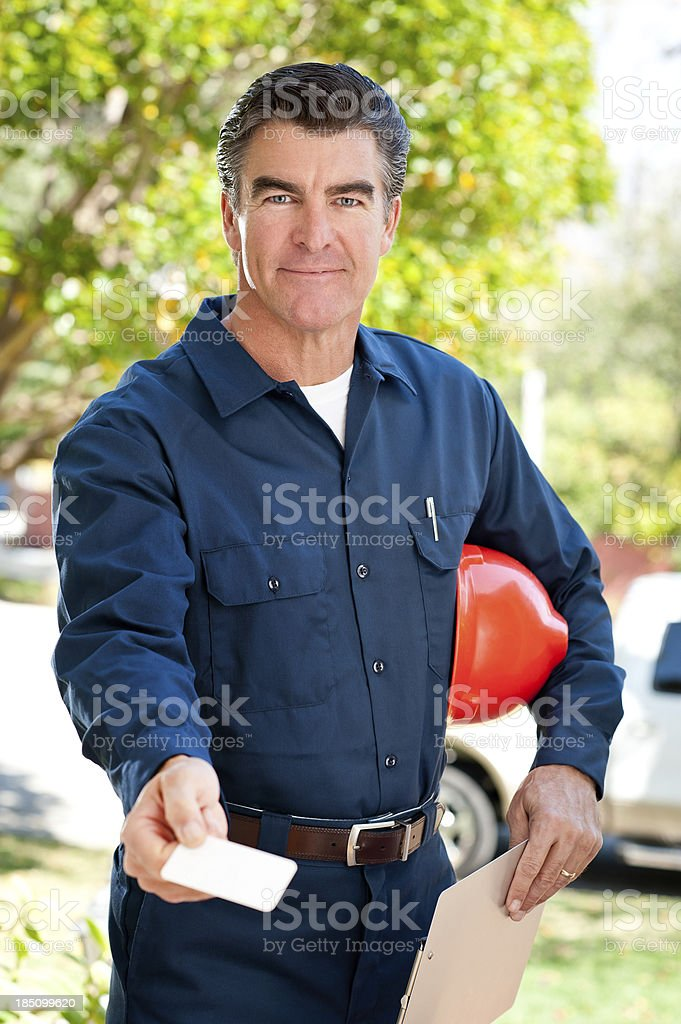 Construction Worker In Uniform & Hard Hat stock photo