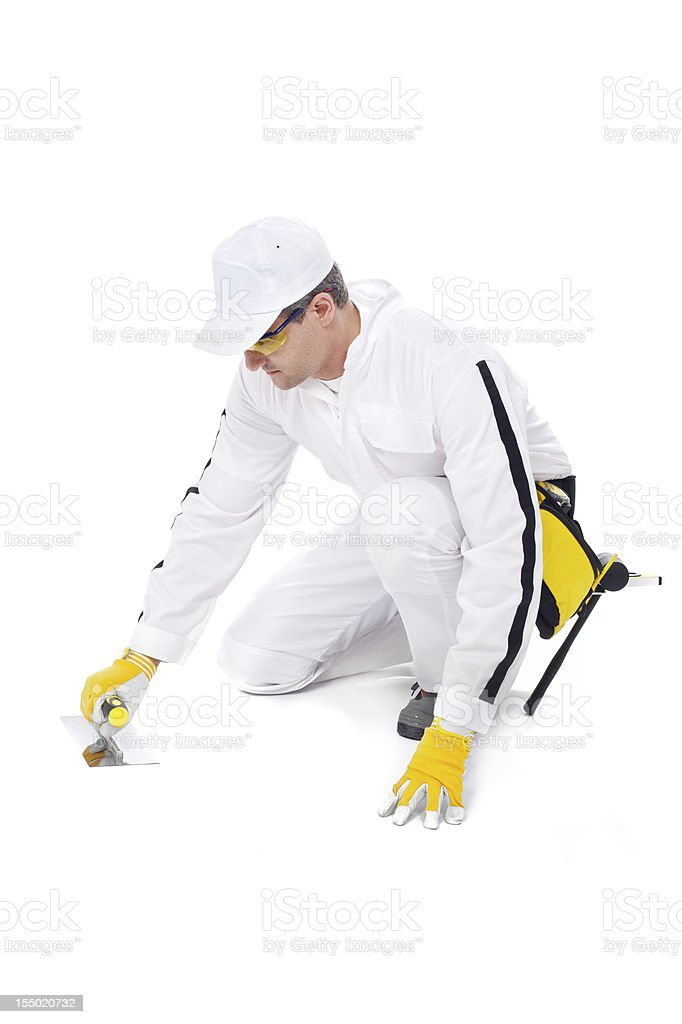 construction worker in white coveralls trowel floor stock photo