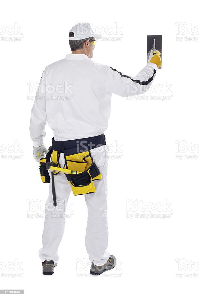 construction worker in white overalls wall putty trowel stock photo