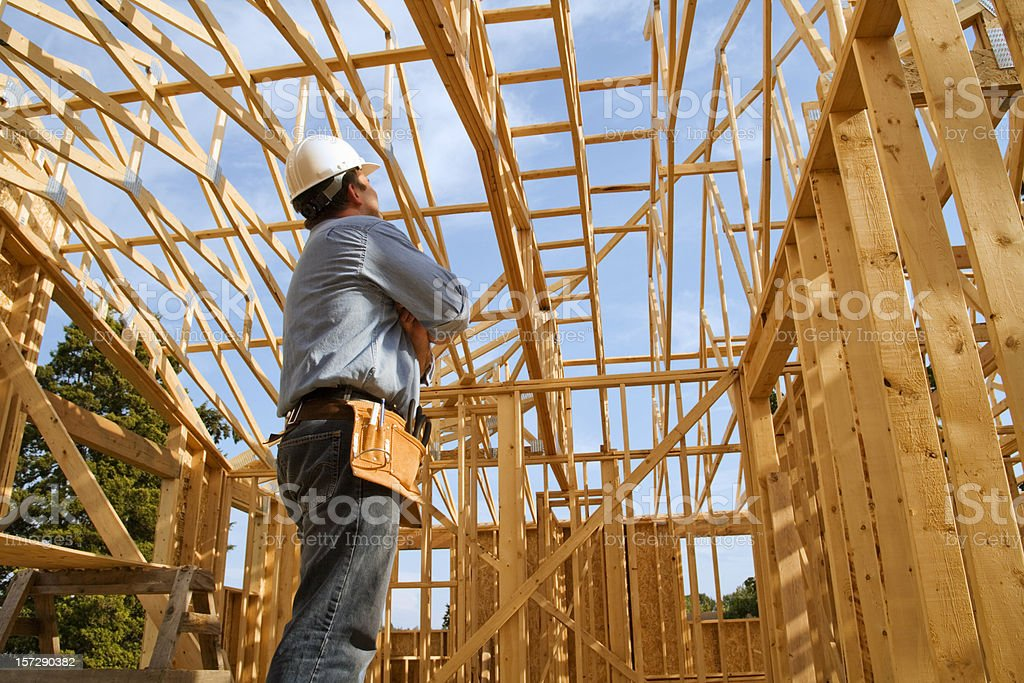 Construction worker in wooden building frame stock photo