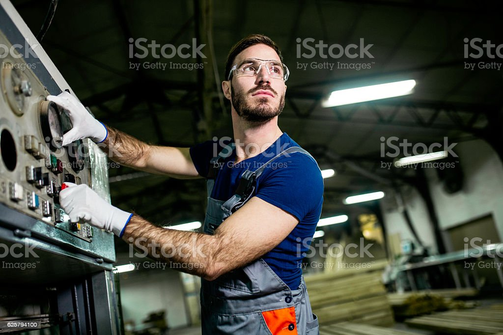 Construction worker inside factory stock photo
