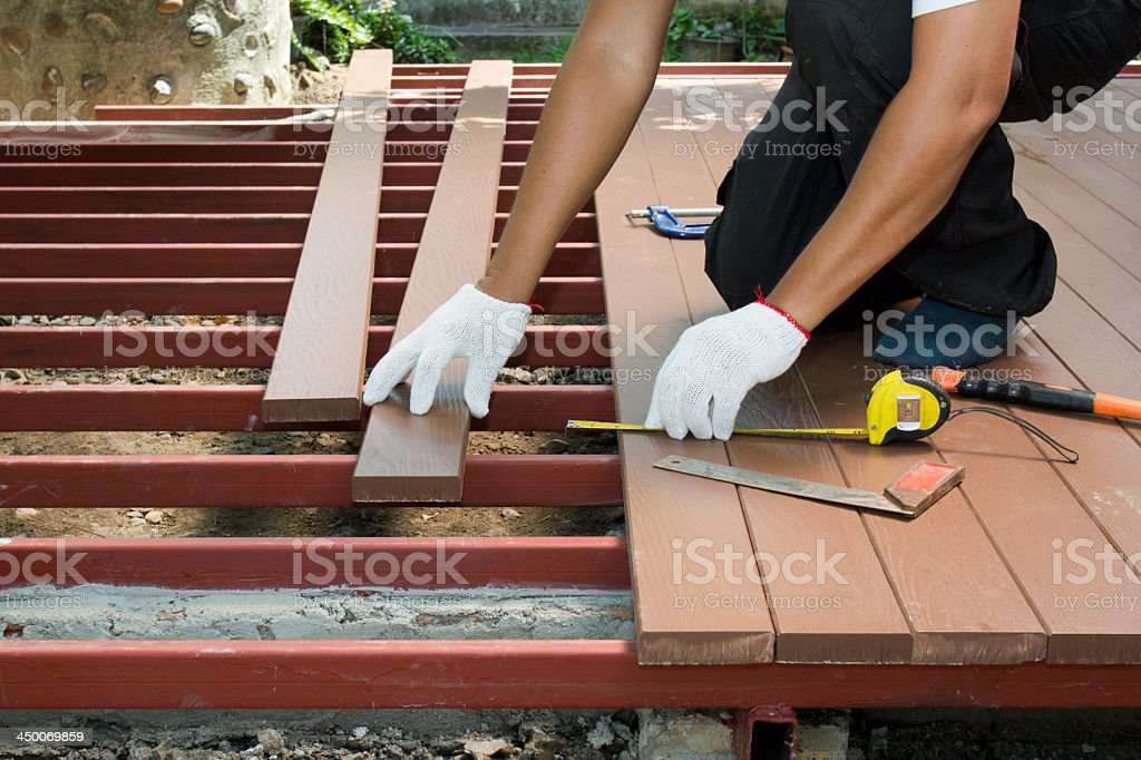 Construction worker installing an outdoor patio stock photo