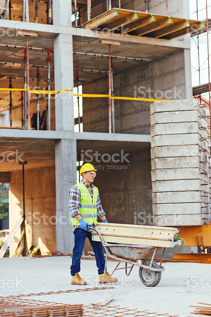 Construction worker is part of engineering team on construction site stock photo