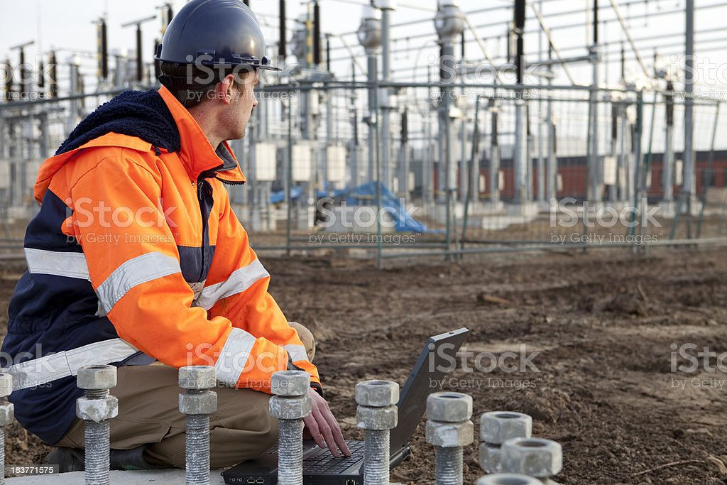 Construction worker is planning to build a power station. stock photo
