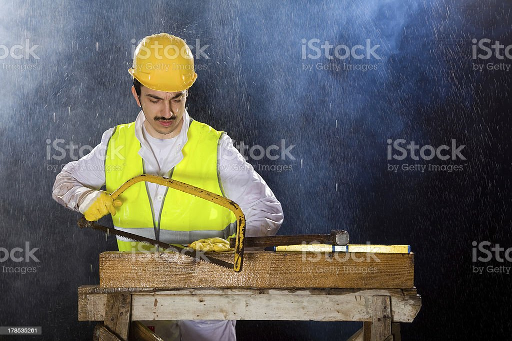 Construction worker is using handsaw royalty-free stock photo