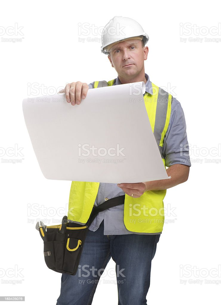 Construction worker looking over plans royalty-free stock photo