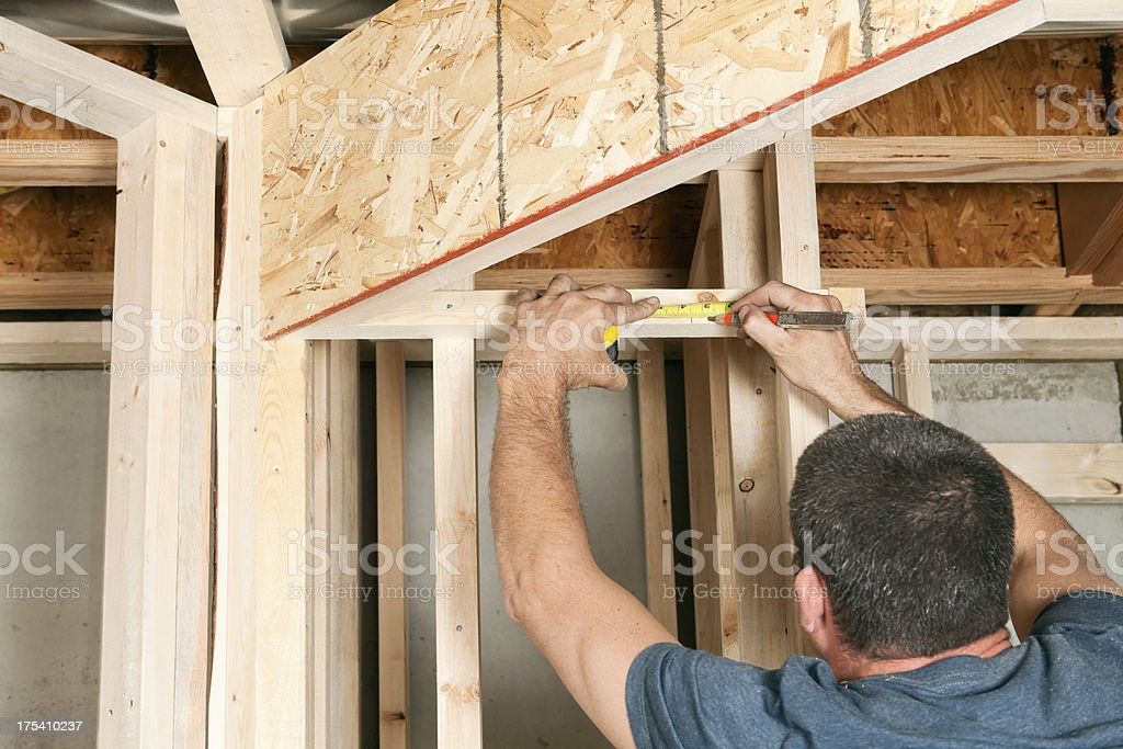 Construction Worker Measuring Board stock photo