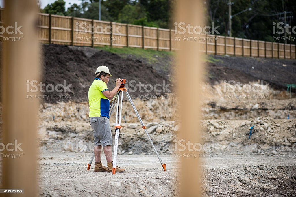 Construction worker measuring stock photo