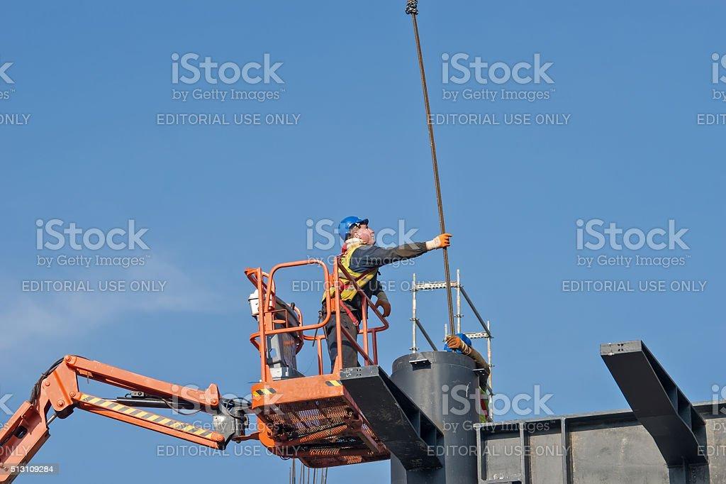 Construction worker on a raised platform 3 stock photo