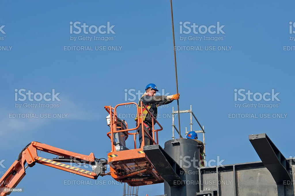 Construction worker on a raised platform 4 stock photo