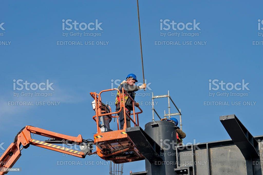 Construction worker on a raised platform 7 stock photo