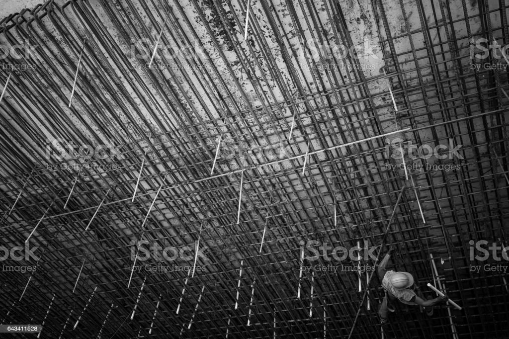 Construction worker on a rebar grid wall stock photo