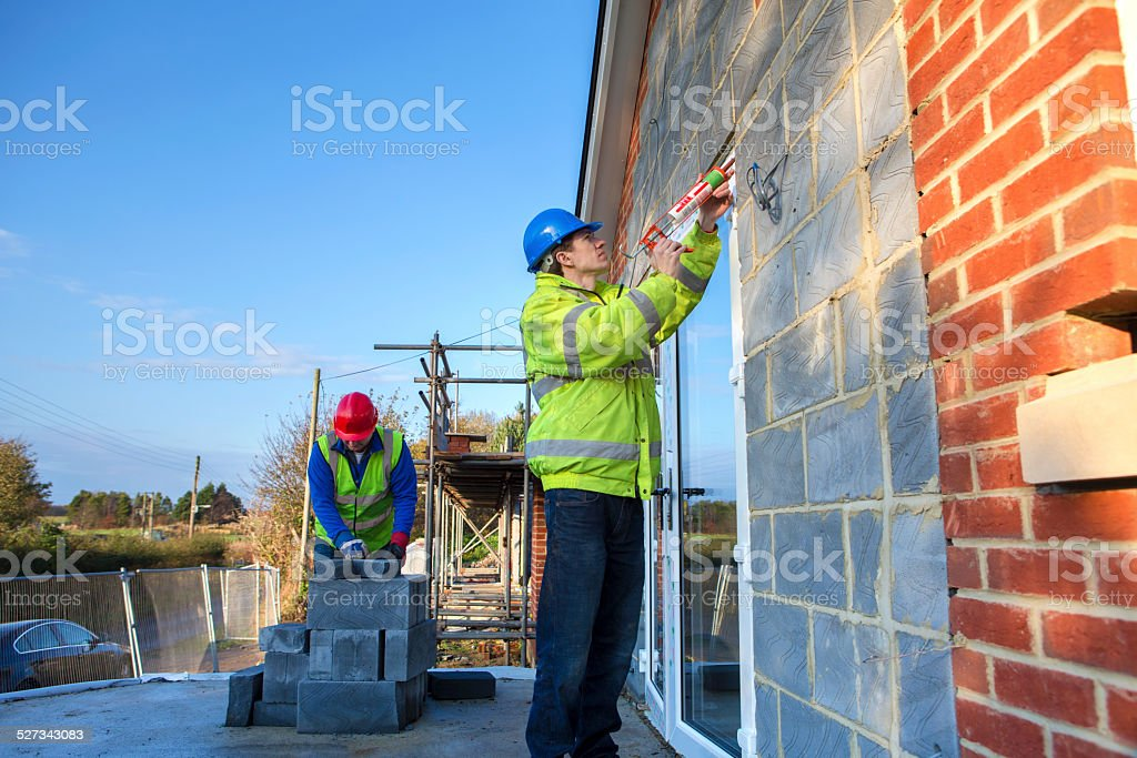 Construction Worker on Building Site stock photo