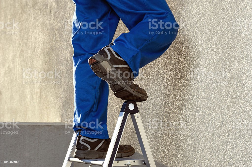 Construction Worker on Ladder royalty-free stock photo