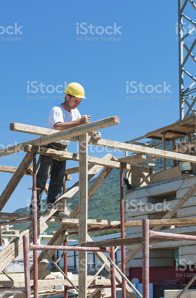 Construction worker on scaffold royalty-free stock photo