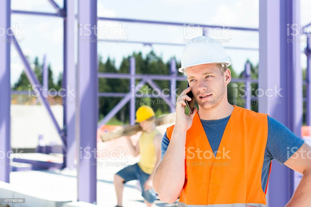 Construction worker on telephone royalty-free stock photo