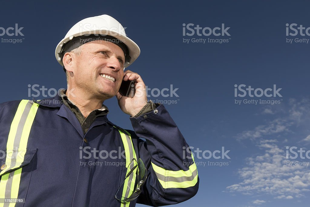 Construction Worker on the Phone royalty-free stock photo