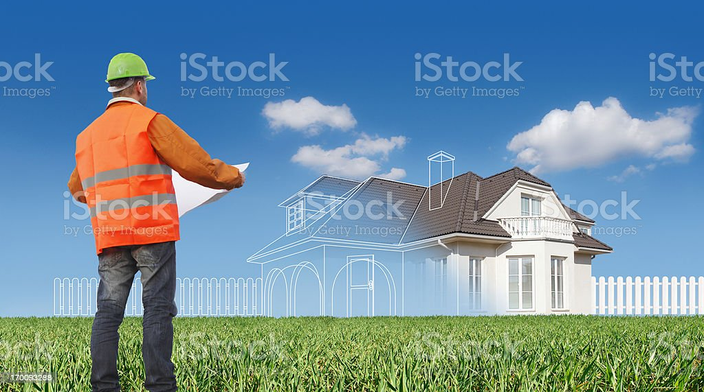 Construction worker planning new house stock photo