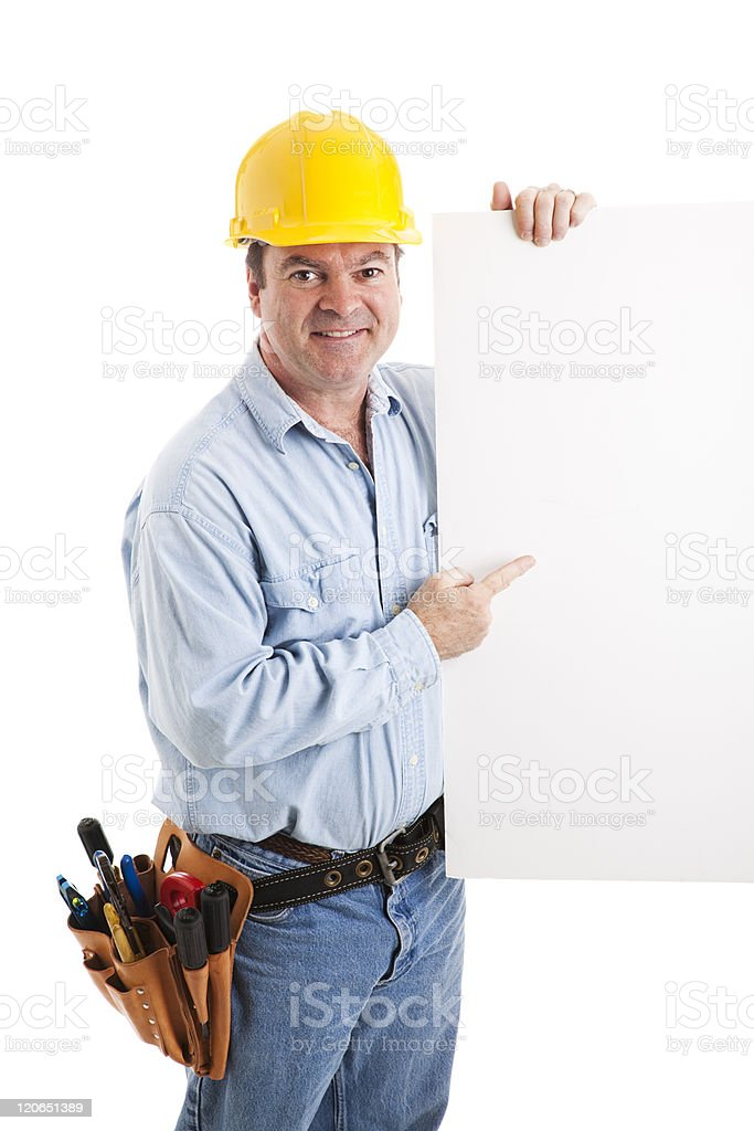 Construction Worker Points to Sign royalty-free stock photo