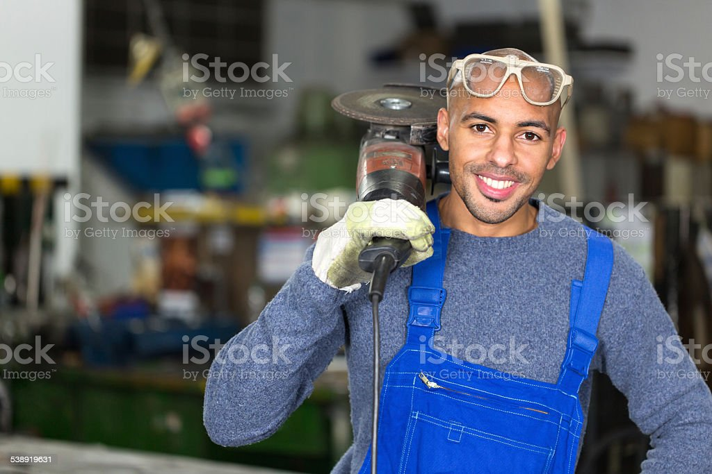 construction worker posing with angle grinder stock photo