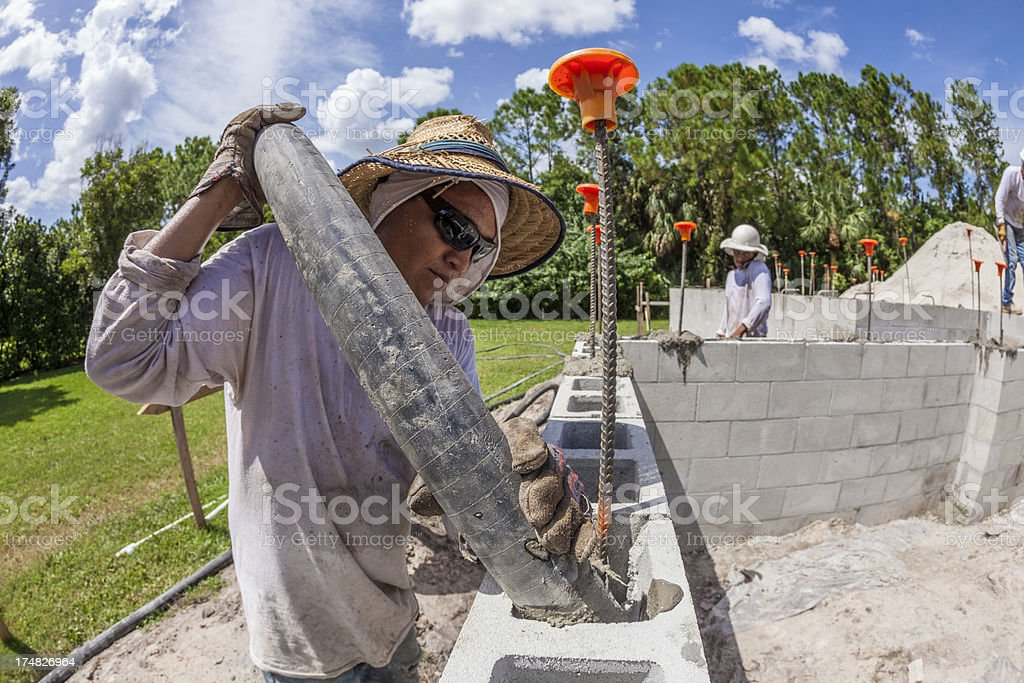 Construction Worker Pouring Concrete on Job Site royalty-free stock photo