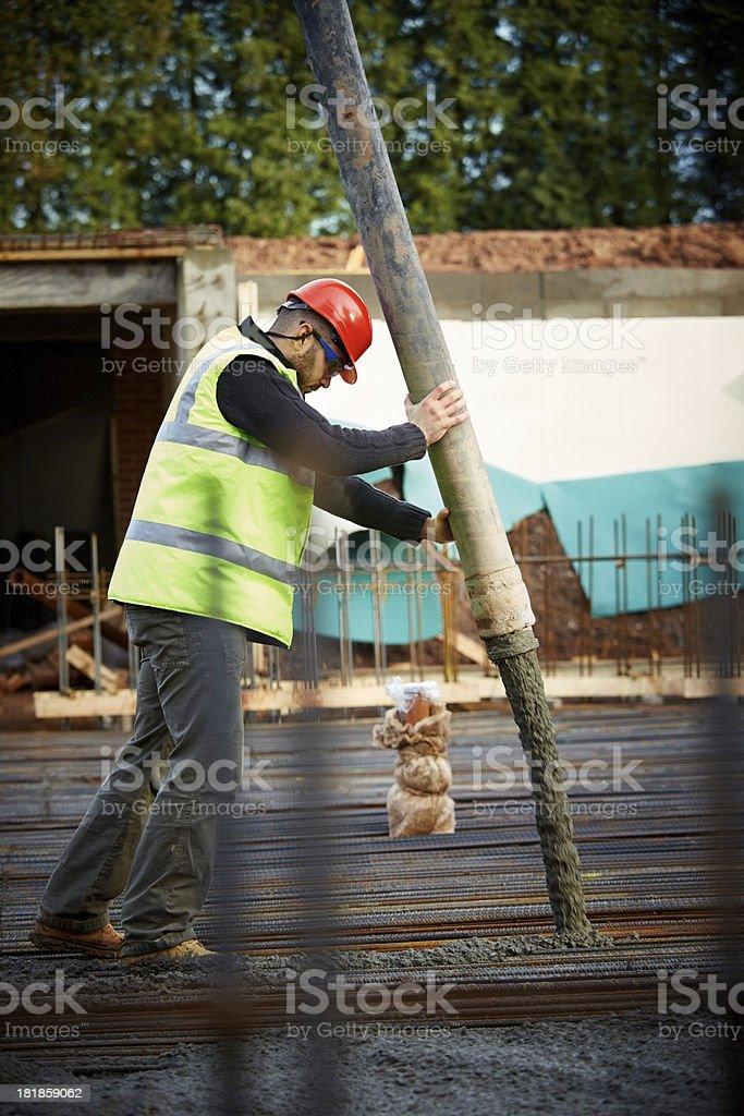 Construction worker pouring foundation concrete stock photo