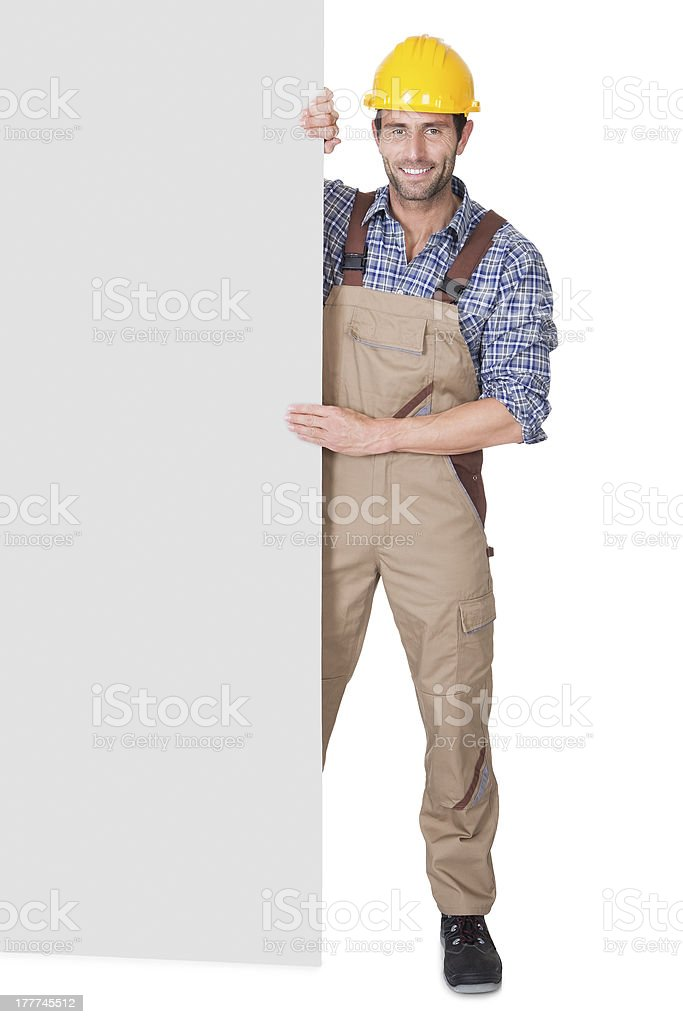 Construction worker presenting empty banner royalty-free stock photo