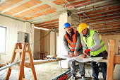 Construction worker reading blueprints