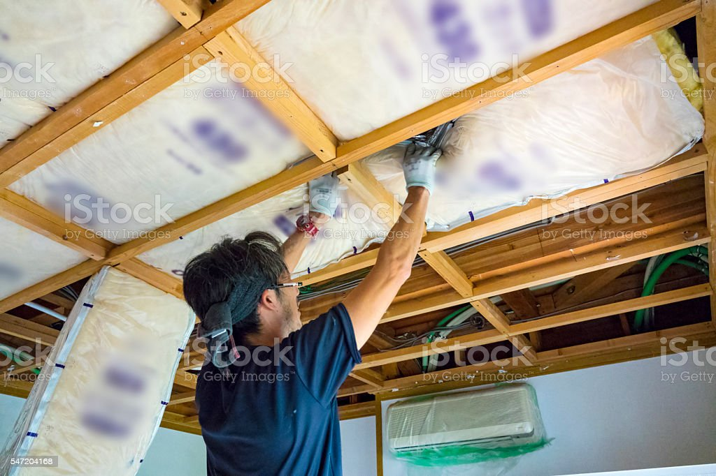 Construction worker remodeling home stock photo