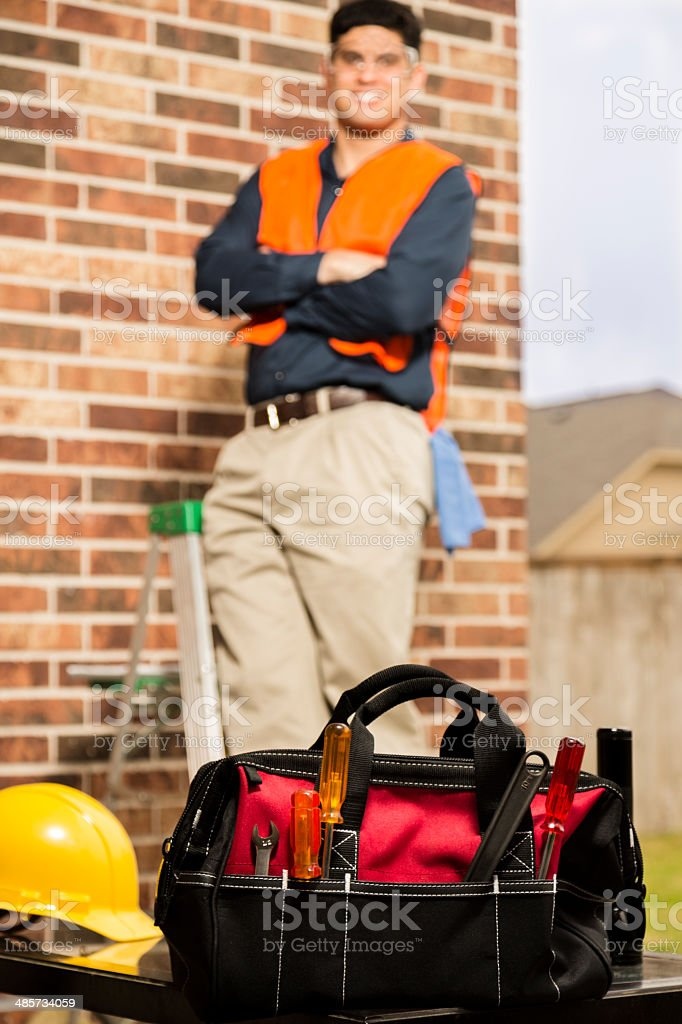 Construction worker, repairman, or inspector at a home. Tools. royalty-free stock photo