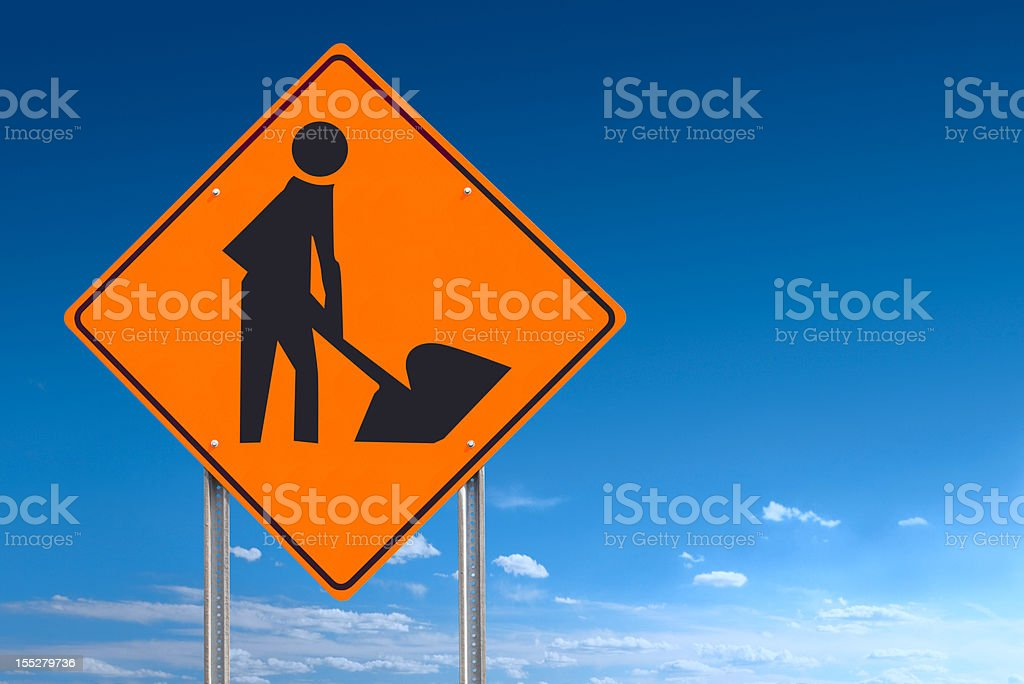Construction Worker Road Sign Post On Blue Sky Clipping Path stock photo
