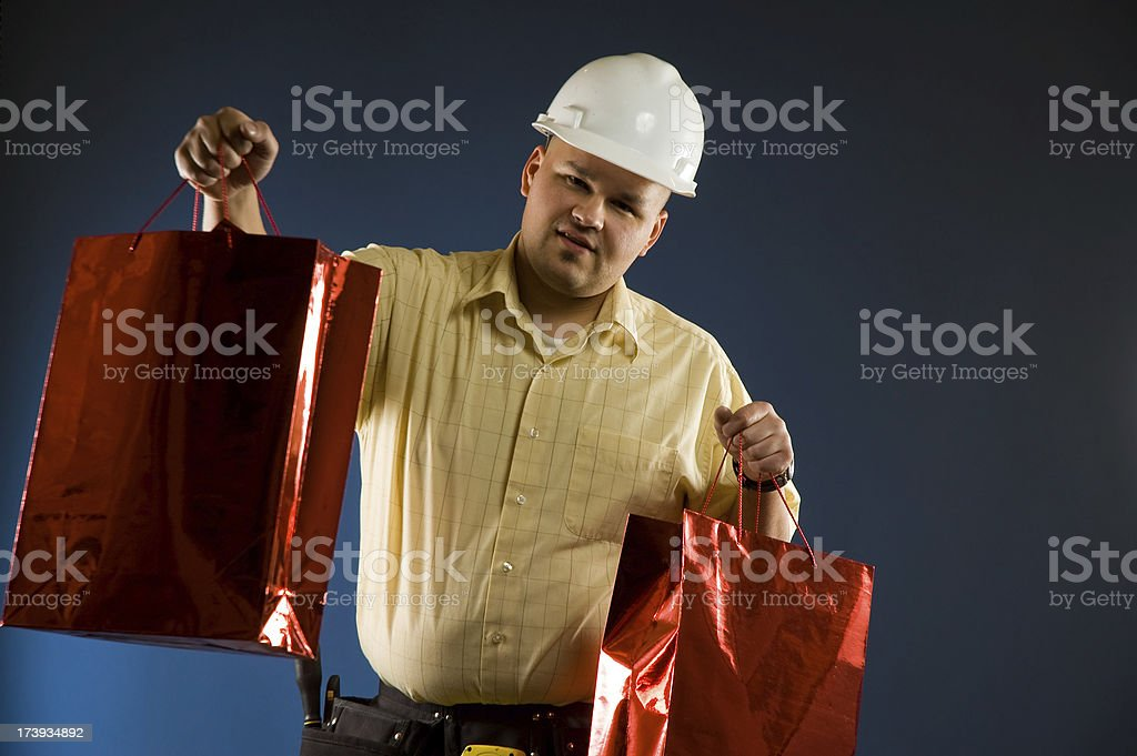 construction worker shopping royalty-free stock photo