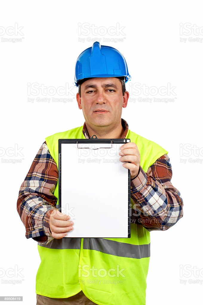 Construction worker showing a blank notebook royalty-free stock photo