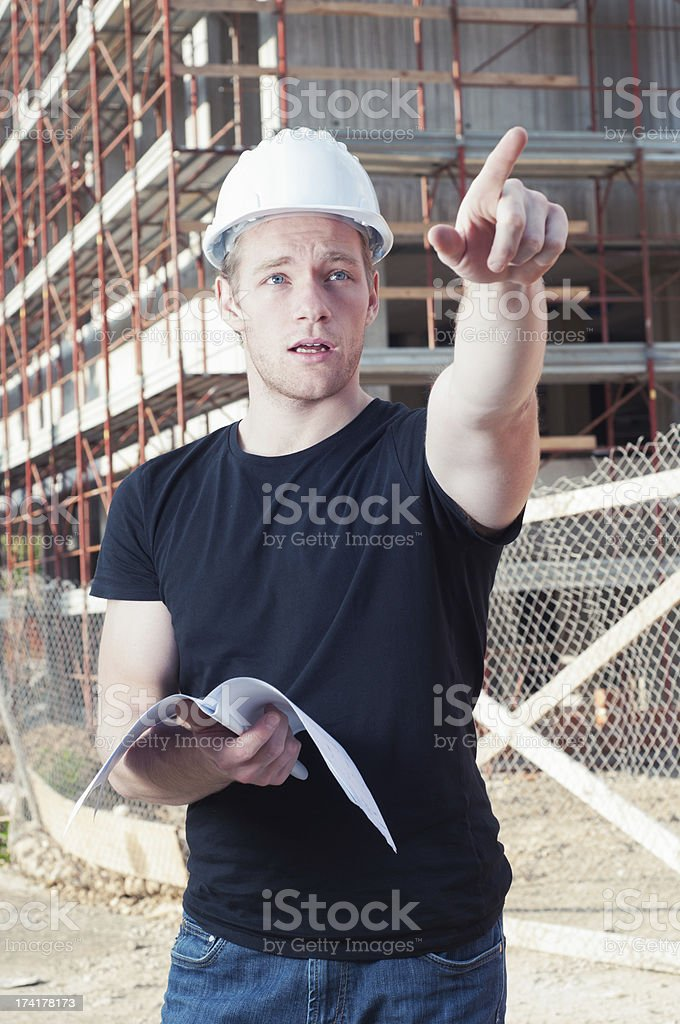 Construction worker showing something royalty-free stock photo