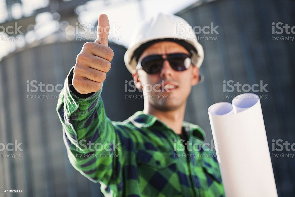 Construction worker smiling and showing thumbs up royalty-free stock photo