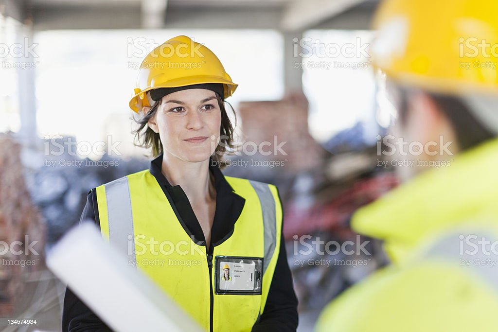 Construction worker smiling on site stock photo