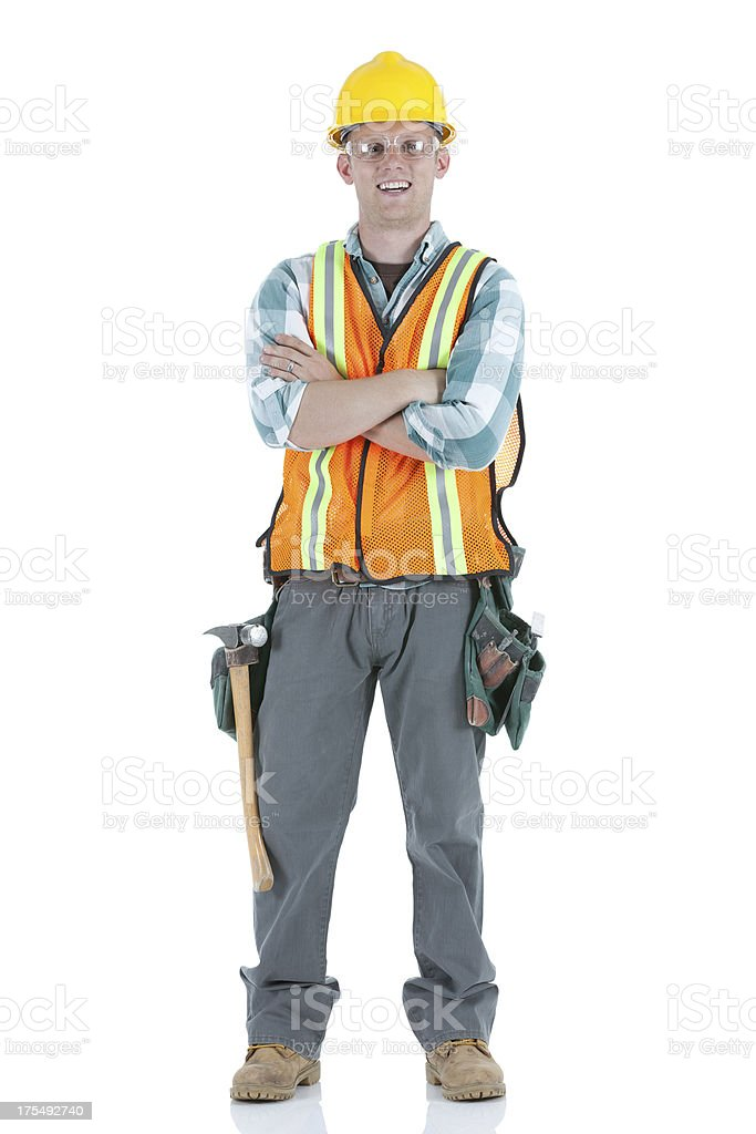 Construction worker standing with his arms crossed royalty-free stock photo