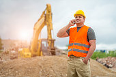 Construction worker takes a call