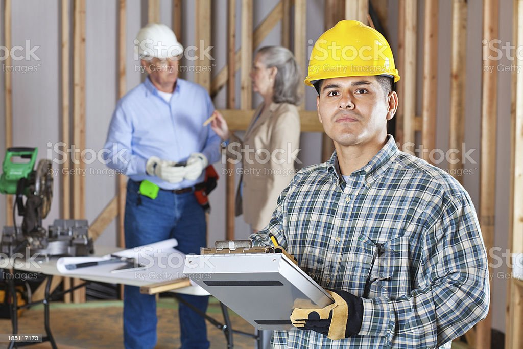 Construction worker taking notes at a work site royalty-free stock photo
